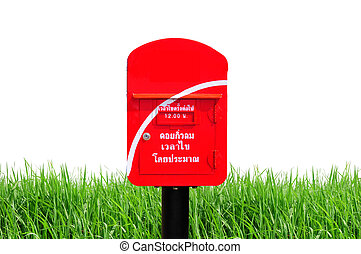 Red thailand post box on green grass and white background