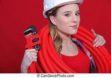 Red themed female plumber