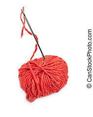Red thread ball and needle with pink thread