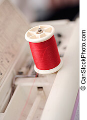 red thread in Sewing machines shallow depth of field (soft focus)