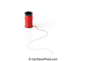red thread loom standing on black thread over white bakcground