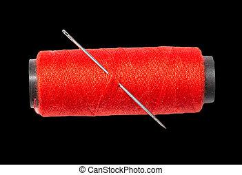 red thread on black background. macro