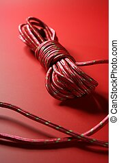 Red thread spool on monochrome background