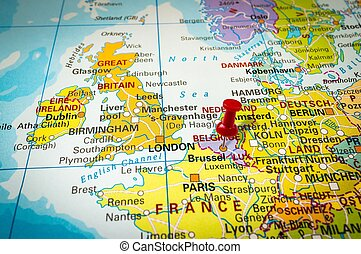 Red thumbtack in a map, pushpin pointing at Brussel