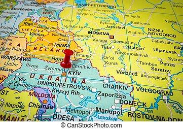 Red thumbtack in a map, pushpin pointing at Kiev