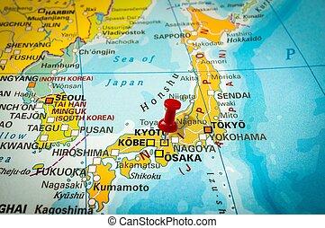 Red thumbtack in a map, pushpin pointing at Kyoto