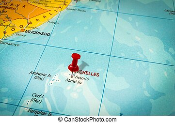 Red thumbtack in a map, pushpin pointing at Seychelles