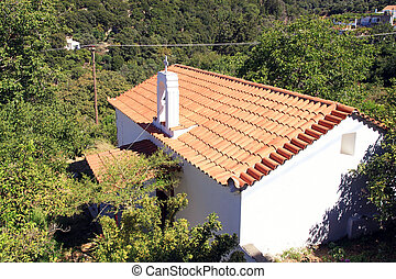 Red tile roof church in mountain village, Crete, Greece