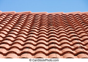 Red Tile Roof Under Blue Sky