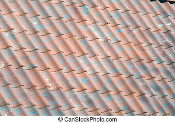 red tile roof with green pieces
