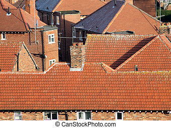 Red tiles on house roofs