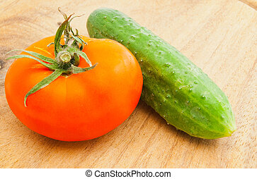 tomato and cucumber on cutting board