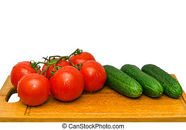 red tomato and green cucumbers on board
