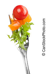 red tomato and salad on a fork
