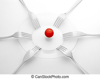 Red tomato and six black and white forks. Sharing, ...