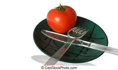 red tomato in green plate
