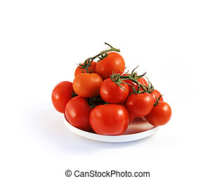 red tomato on a plate