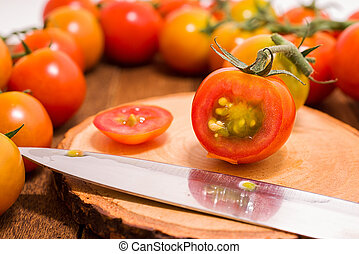 Red tomato slices on cutting board