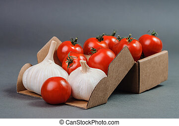 Red tomatoes and couple of garlic.