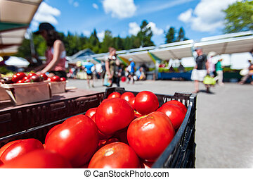 Red tomatoes for sale at the farmer's market