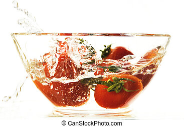 Red tomatoes in a plate with water