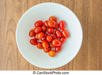 Red tomatoes in a white bowl