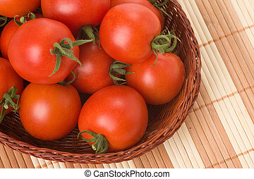 red tomatoes in basket