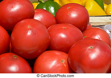 red tomatoes in wooden crates - lot of ripe tomatoes in...