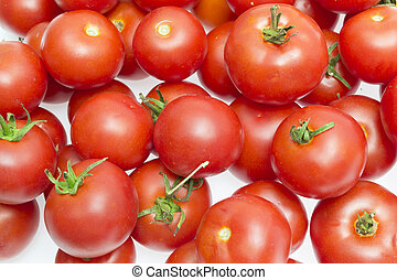Red tomatoes isolated on a white background