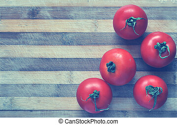 Red tomatoes on a cutting board