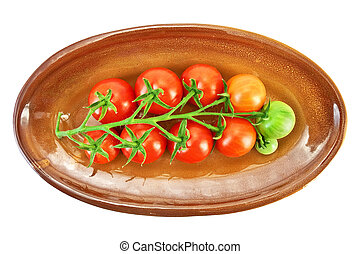 Red tomatoes on a plate