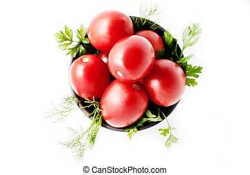 Red tomatoes on a plate, isolated background