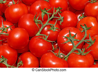 red tomatoes on vegetable market