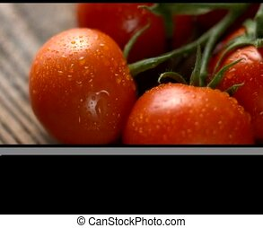 red tomatoes with basil on wood - close up video of red...