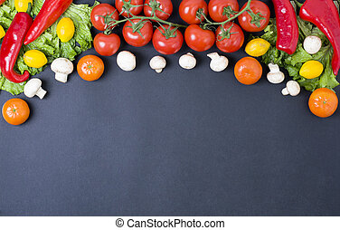 Red tomatoes with greens and tangerines on a black background. Mushrooms with tangerines and red pepper in the composition.