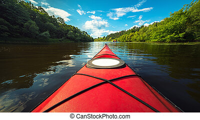 Red tourist kayak on a calm river