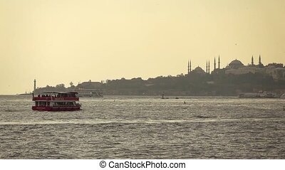 Red touristic walking ship in a Bosphorus strait with view...