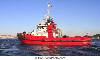 Red tow boat - Pilotage service boat in front of harbor.