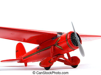 Red toy Aeroplane, closeup on a white bagground