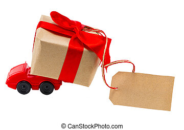 Red toy car delivering gifts box with tag with empty space for a text on a white background