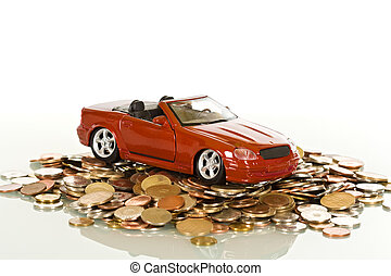 Red toy car on coins