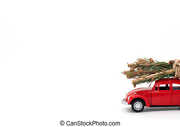 Red toy car with christmas tree on the roof