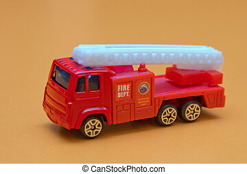 Red toy fire truck / Very fast to rescue children safe from fire.