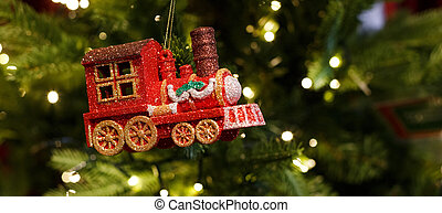 red toy locomotive hanging on the Christmas tree