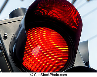 red traffic light - a traffic light shows red light on the...