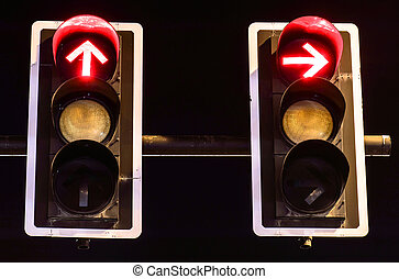 Red traffic lights on night background