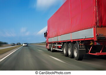 red trailer on the highway - trailer with red awning moves...