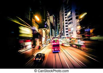 Red tram at modern city street. Motion blur. Hong Kong