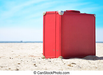 Red Travel Suitcase on Sunny Beach - A red travel suitcase...