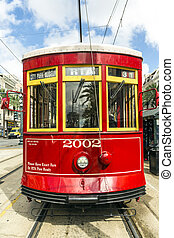 red trolley streetcar on rail in New Orleans French Quarter...